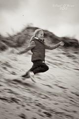 Sarah (Paul O'B) Tags: ireland motion blur beach girl speed dune run pan wicklow brittas borderfx