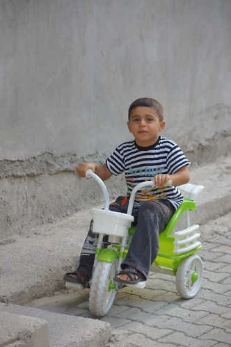 Siirt boy with his lime-green-and-white tricycle by CharlesFred