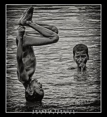 Turag Boys (Shabbir Ferdous) Tags: bw white playing black boys water photographer shot action dhaka capture bangladesh bangladeshi turag ef70200mmf28lisusm shabbirferdous canoneos1dmarkiv wwwshabbirferdouscom shabbirferdouscom