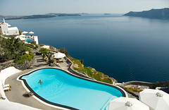 Swimming pool at Santorini (erwin1964) Tags: travel flowers blue sea people woman plants holiday men green water pool swimming hotel mediterranean outdoor turquoise relaxing swimmingpool santorini greece human geography surrounding erwin deckchairs parasols sunbeds zueger erwinzueger