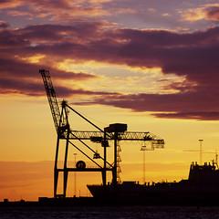 Heavy (Konrad Beckmann) Tags: ocean light sunset sea sun water silhouette backlight clouds twilight industrial sweden harbour crane dusk hasselblad velvia velvia100 heavy malm pushprocessed rvp100 503cw epsonv700 dockan sonnar250mm