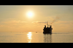 liquid gold ([ Chiara ]) Tags: sea sunrise gold boat ship sicily lipari