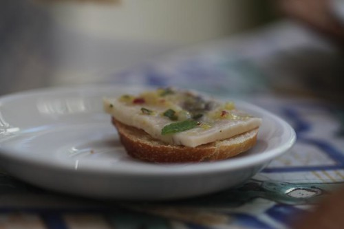 swordfish carpaccio with lemon on crostini