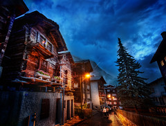 The Streets of Zermatt (Stuck in Customs) Tags: world wood old travel blue vacation ski architecture night clouds digital photography switzerland evening town blog high twilight europe european quiet republic village suisse dynamic stuck swiss traditional country july historic resort photoblog rainy software processing imaging zermatt matterhorn svizzera range hdr tutorial canton trey ch travelblog customs valais dieschweiz cabins 2011 svizra ratcliff visp hdrtutorial stuckincustoms swissconfederation treyratcliff photographyblog stuckincustomscom nikond3x