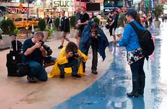Times Square NYC before hurricane Irene (Tatyana Kildisheva) Tags: nyc newyorkcity rain puddle hurricane timessquare gothamist rubberboots curbed hurricaneirene q8277727