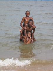 Lake Malawi fun (vincentello) Tags: boy lake beach kids children lac wave malawi vague plage garon chipoka