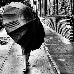 Meet Irene (magneticart) Tags: nyc urban storm weather umbrella walking square wind hurricane streetphotography squareformat irene normal hurricaneirene magneticart iphoneography instagramapp uploaded:by=instagram magneticpiccom giovannisavino irenenyc