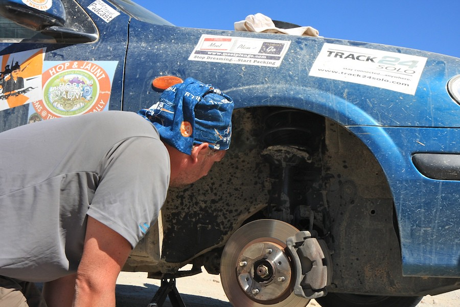 fixing a tire during the mongol rally