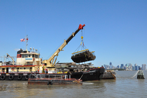 DCV Hayward loads debris in New York & New Jersey Harbor