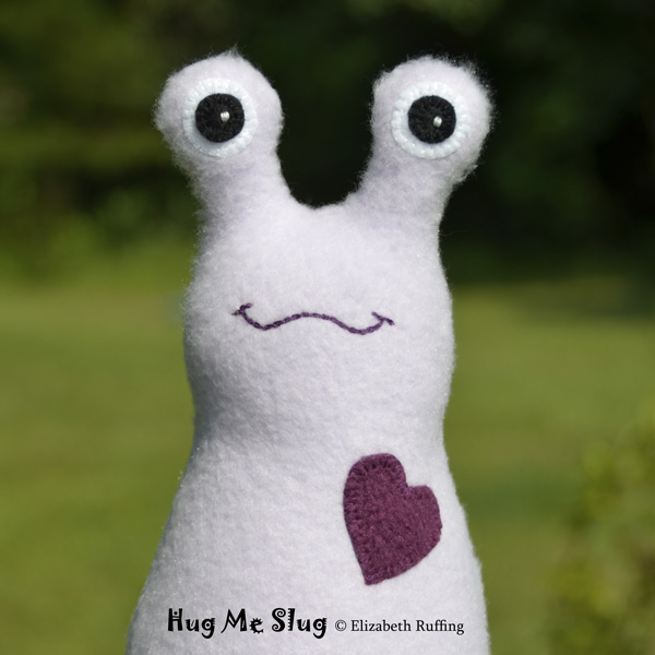Light lavender fleece Hug Me Slug original art toy by Elizabeth Ruffing