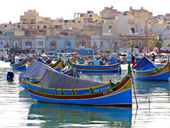 Fishing Boats in Marsaxlokk (Colorado Sands (little break)) Tags: homes architecture boats botes harbor boat fishing arquitectura europa europe mediterranean barca european barcos harbour structures malta barche boote bateaux explore boating architektur anton nautical fishingboats bateau watercraft fishingvillage southerneurope fishingfleet mditerrane marsaxlokk woodboats explored republicofmalta sandraleidholdt bateaudepche paintedboats leidholdt