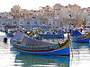 Fishing Boats in Marsaxlokk (Colorado Sands) Tags: harbor fishingboats harbour structures homes anton malta marsaxlokk fishingvillage southerneurope european boating barcos boote woodboats paintedboats republicofmalta mediterranean méditerranée fishing barca fishingfleet botes bateaudepêche explore explored bateau architektur architecture arquitectura europa bateaux europe watercraft nautical sandraleidholdt boats boat barche