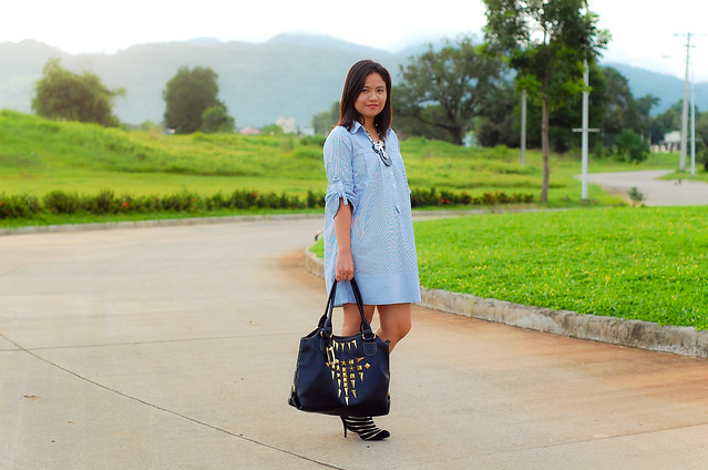 Pin stripe dress, gold stripe booties and gold studded purse
