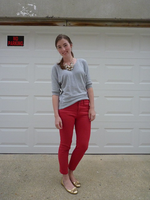 red pants, grey sweater
