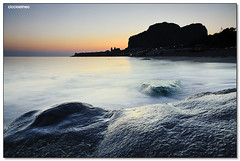 Cefalu' - On the rock (ciccioetneo) Tags: longexposure summer vacation italy orange holiday water silhouette rock speed sunrise nikon long exposure italia estate slow cathedral alba smooth creative sigma commons cc creativecommons shutter sicily 1020mm palermo vacanza sicilia silky cefalu slowshutterspeed glows sigma1020mm d7000 nikond7000 ciccioetneo