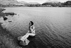 girl, rock and loch (gorbot.) Tags: blackandwhite bw swimming roberta lochawe f19 kilchurncastle leicam8 digitalrangefinder ltmmount voigtlander28mmultronf19