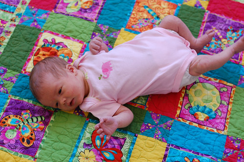 Eva on a quilt from Granny