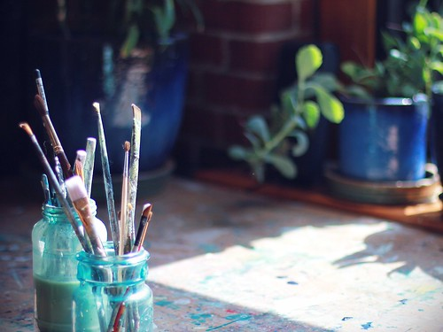 brushes, table, plants, window