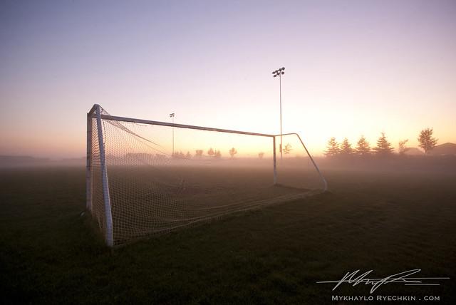 Soccer net at sunrise