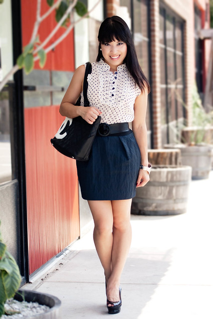 forever 21 polka-dot blouse, agaci black sash belt, tjmaxx elizabeth and james crepe navy skirt, bebe zahara slingback pumps, chanel logo tote, forever 21 leaf bracelet