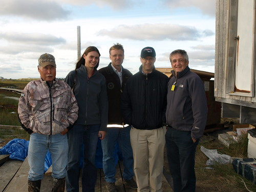 Left – Right, President of the Village of Kwigillingok, Johnny Friend, joins Tasha Deardorff, Matt Dixon, Jonathan Adelstein and Jim Nordlund at a site where RAVG funded a flush, tank and haul upgrade for a village home.