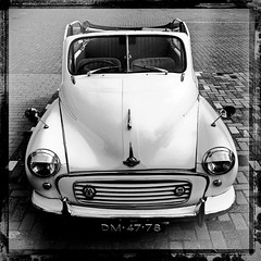 Morris Minor (LiesBaas) Tags: auto bw car forsale stones headlights bumper seats hood aa oldtime kinderkopjes iphone vehicule zw tegels wagen whitecar vehikel koplampen 2011 keien iphotography iphonography zwartwitfotografie liesbaas hipstamatic dm4778 zittingen morrisminorbyliesbaas