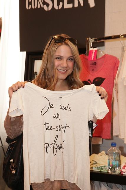 Lauren Collins checks out a ConScent T-shirt