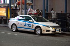 NYPD Ford Hybrid (rocketdogphoto) Tags: usa newyork manhattan nypd midtown timessquare policecar newyorkpolicedepartment fordfusion