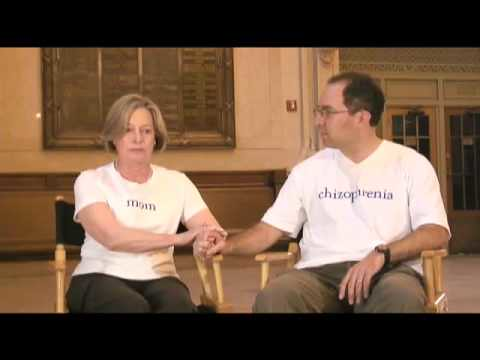 Two people wearing white shirts, one a woman with 'mom' and the other a man with 'schizophrenia.'