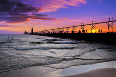"""Sunset silhouette""   Grand Haven Lighthouse - Grand Haven , Michigan (Michigan Nut) Tags: travel sunset sky usa lighthouse reflection beach nature girl silhouette clouds america geotagged outdoors photography pier pretty waves michigan scenic structure historic lakemichigan greatlakes johnmccormick grandhavenlighthouse"