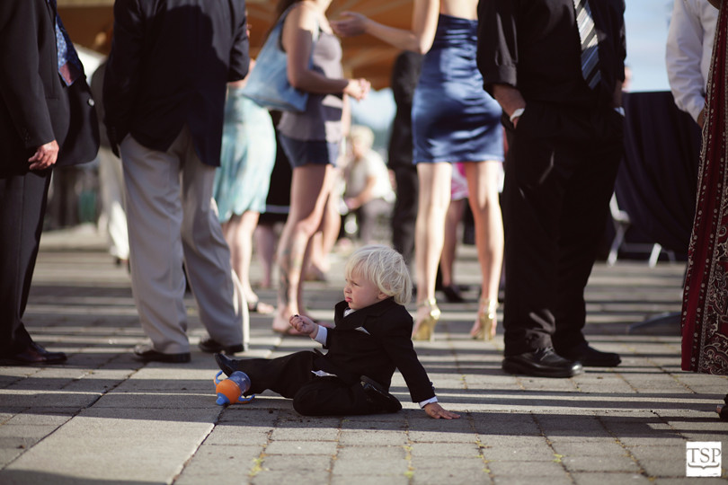 Child Sitting During Wedding