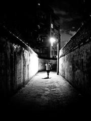 lonely street (imsuri) Tags: china road boy shadow portrait people blackandwhite man night alone bokeh chinese streetlife panasonic nightlight chinadigitaltimes 20mm nanning  f17 2011 gf1  project365 streetsnap microfourthird  34photography