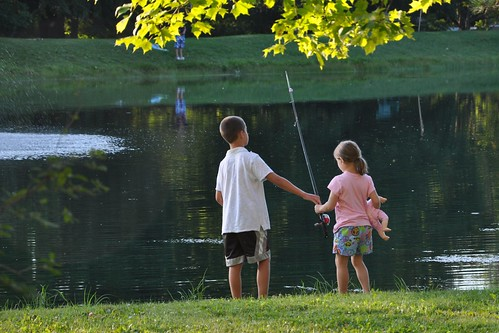 Carson and Alana fishing...with doll in tow