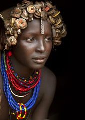 Dassanech girl with caps wig - Omorate Ethiopia (Eric Lafforgue) Tags: woman cute beer girl beauty face artistic culture tribal ornament tribes cocacola bodypainting tradition tribe recycling ethnic hairstyle rite tribo adornment pigments ethnology tribu eastafrica thiopien etiopia ethiopie etiopa galeb 9869  etiopija ethnie ethiopi  dassanech etiopien etipia  etiyopya  nomadicpeople    dasanech dassanetch   daasanach dasenach dassanach    peoplesoftheomovalley