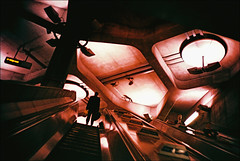 stations of the tube #6 - westminster (chirgy) Tags: man london westminster silhouette underground concrete lights xpro escalator tube shapes winner brutalist olympusxa 1124 fujisensia100 myday2011