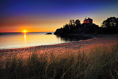"""McCarty's Cove""  Marquette Harbor Lighthouse - Marquette , Michigan (Michigan Nut) Tags: morning coastguard usa lighthouse beach silhouette america sunrise landscape geotagged dawn sand midwest rocks lighthouses cove michigan footprints landmark greatlakes upperpeninsula lakesuperior marquette michiganlighthouses marquettecounty johnmccormick mccartyscove marquettelighthouse"