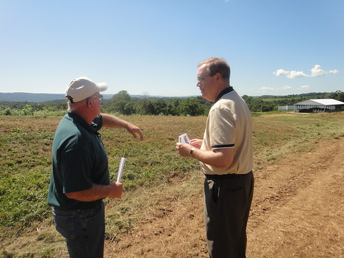 Mac Curtis (left), owner of Windview Farm in Port Treverton, explains to Rural Development Under Secretary Dallas Tonsager how his farm has benefited from the promising technology of a poultry litter incinerator that reduces his energy costs and the amount of nutrients flowing into the Chesapeake Bay.