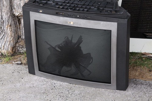 Broken shadow mask on a thrown out TV