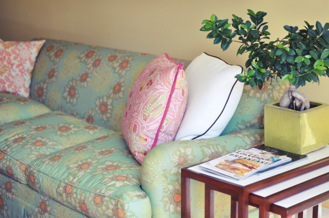 floral print couch + yellow walls + nesting tables + santa monica