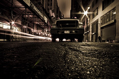 Downtown Manhattan (geezaweezer) Tags: usa sepia night america canon lights downtown pavement manhattan 4 accept toned streetview reject1 reject2 accept1 longshutterrelease accept2 accept5 accept3