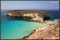 Isola dei Conigli (Lampedusa) (DiegoGuidone) Tags: pictures desktop light italy art beach colors canon landscape geotagged eos photo nice barca italia mare foto picture sigma diego playa natura belle wallpapers fotografia roccia per azzurro colori spiaggia dei conigli isola lampedusa sfondo sfondi tema photografy scoglio photocard 18250 550d guidone tabaccara