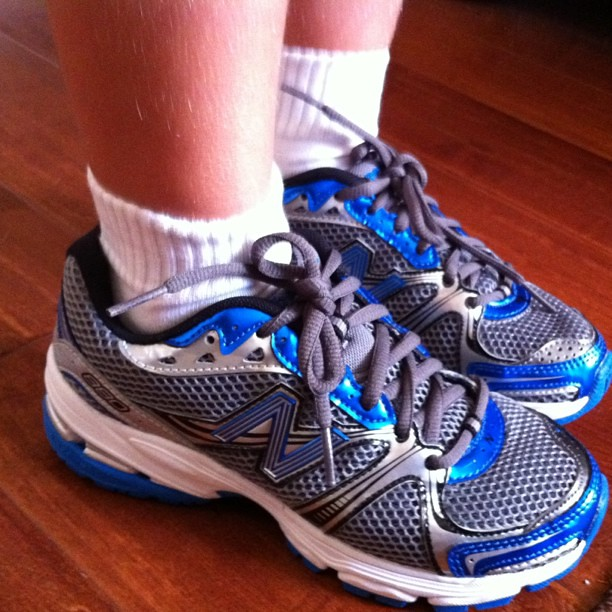 Angry Kid's brand new size 2 @newbalance running shoes. He ran all the way to school today. He was a 13 last week.