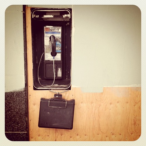 A payphone with phone book? When am I?