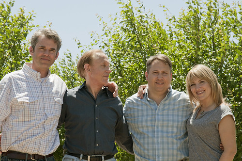 Members of the Wilbur family (from left to right) John Friend, Rick Wilbur, Richard Wilbur and Emily Friend, gather on their farmland in California's Sacramento Valley. As the owners and operators of the Wilbur Packing Company, they have had great success exporting prunes and walnuts to international markets with assistance from the Foreign Agricultural Service's (FAS) export programs.