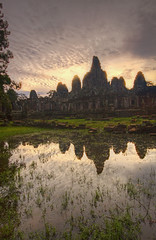 Sunrise at Bayon Temple (Matt Champlin) Tags: life old morning travel reflection history tourism rain clouds sunrise canon temple dawn amazing ancient asia cambodia southeastasia peace khmer buddha buddhist angkorwat exotic kings monsoon temples getty historical indianajones moats bayon angkorthom siemriep ancienttemples 2011 bayontemple sunriseatbayon sunriseatbayontemple