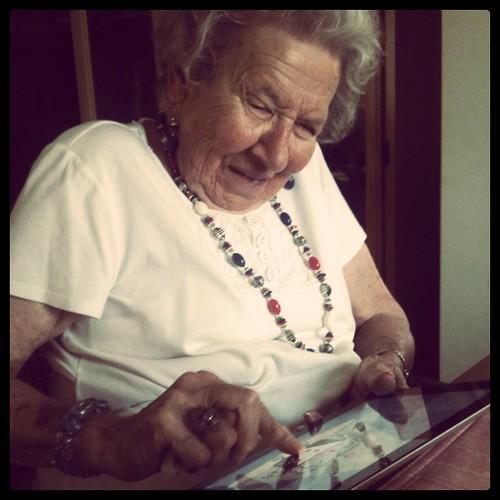 My grandma playing with my iPad happily.