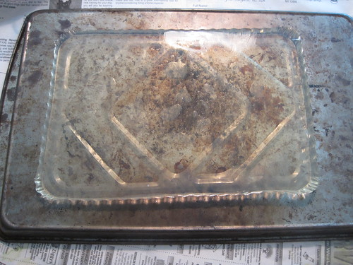 the gelatin plate sitting on the bottom of a nasty looking cookie sheet