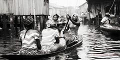 itsafamilyaffair (Lolade Cameron-Cole) Tags: woman water evening lagoon lagos canoe westafrica nigeria paddling lagoslagoon