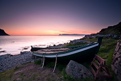 The rowboat lver - Bolungarvk - Iceland (Arnar Bergur) Tags: ocean sunset sea orange green grass rock clouds sunrise canon landscape iceland purple stones shore rowboat 5d fishingboat arnar 1740 westfjords 19century bolungarvk dockbay lver svr visipix