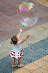Circles (Menton, France) (jpaulus) Tags: girl soap play little skirt bubble reach d700